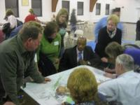 At a February 2011 meeting, Upper Holmesburg residents review neighborhood plans. Civic Association member Paul DeFinis (not pictured) is a graduate of the Citizens Planning Institute. File Photo/Shan