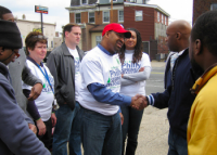 Mayor Michael Nutter (hat) meets Heavy Hitta's boxing coach Lonnie Haile at the 2011 Philly Spring Cleanup on Rising Sun Avenue. Also pictured on left are clean-up organizers Kathy Wersinger of 9t