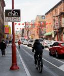 The 10th Street bike lane in Chinatown during its pilot phase.