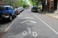 A sharrow on Spruce Street indicates that bikes and cars must share the lane.