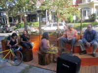 Some of the Logan parklet's first visitors used the various seating options in the