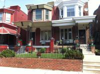 The 1100 block of S. Wilton Street in Kingsessing has tidy twins with well-kept front yards and spotless sidewalks.
