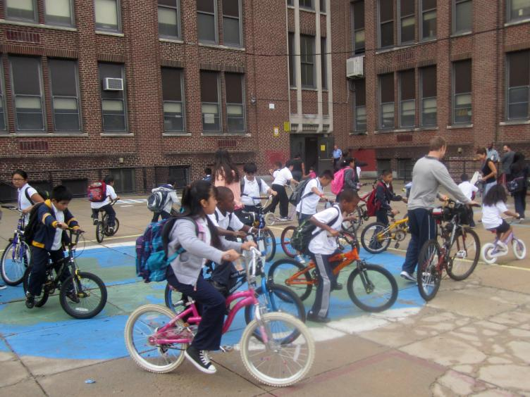 Students gathered in the George Washington Elementary School courtyard after walking and biking to school Thursday.