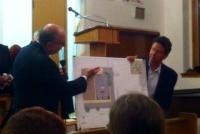 Peter Kelsen and developer Richard Soloff displayed renderings of the proposed Bottom Dollar Food store.
