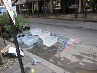 Philadelphia Water Department shows stormwater runoff concerns in its PARK(ing) Day spot.
