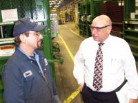 Garry Fadula, Vice President of Operations at PTR Baler & Compactor Co., talks with a longtime co-worker.