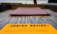 Notice of a ZBA hearing posted to a vacant house in Point Breeze