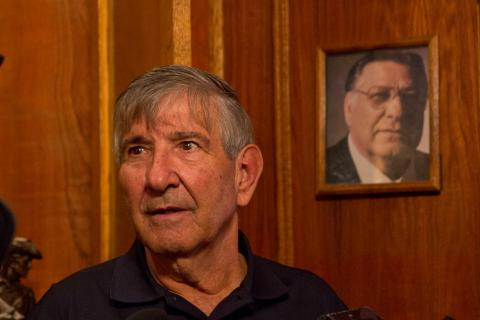 Image Description: Frank Rizzo Jr. said he will hold onto some family photographs but most of the estate is for sale. (Kimberly Paynter/WHYY)