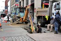 Image Description: Philadelphia Water Department workers excavate at the intersection of 5th and Chestnut. (Emma Lee/WHYY)