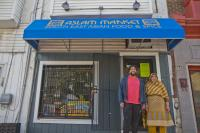 Irshad and Zakria Aslam in front of their award-winning storefront on South 7th St. (Kimberly Paynter/WHYY)