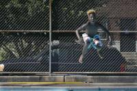 Quamir Jones does a cannonball into the pool at Dendy Playground, at 10th and Oxford streets in North Philadelphia.