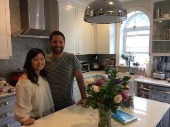 Jennifer Tran and Eric Griffin in the spacious, airy kitchen of their Francisville home.