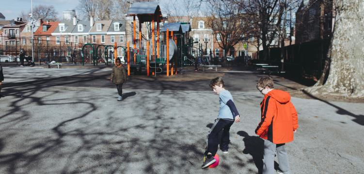Kickball in Weccacoe Playgorund. (Neal Santos for PlanPhilly)