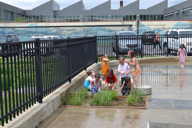 Kids splashed in the new Shissler Rec Center sprayground plant feature