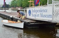 Launching the skiff Nemo, which was built at the museum.