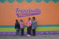 Longtime community members and park-users posed in front of the new mural