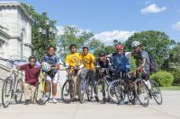 Members of the The National Youth Bike Council pose at the Please Touch Museum before a group ride through Fairmount Park. (Angela Gervasi for WHYY)