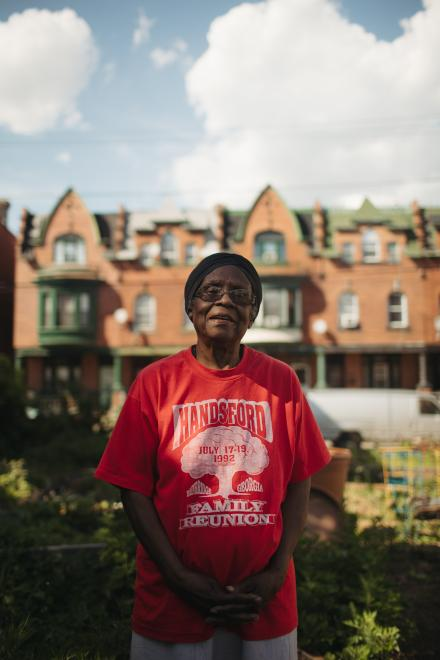 Mildred Johnson in the Viola Street Community Garden. She has lived in East Parkside since 1956. / Neal Santos for PlanPhilly