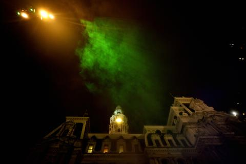 Mist catches green rays of light as it billows up towards the sky during the public unveiling of Pulse at Dilworth Park on Wednesday.