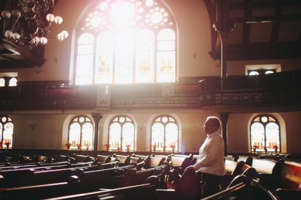 Mother Bethel A.M.E. archivist, Margaret Jerrido, in the church's historic sanctuary. (Neal Santos for PlanPhilly)