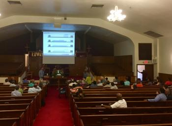 Neighbors gather at Enon Tabernacle Baptist Church Thursday to consider the Boys and Girls Club proposal