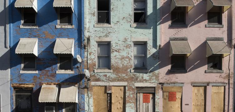 A row of houses, colorful but in need of substantial repairs, on North 27th Street in North Philadelphia.