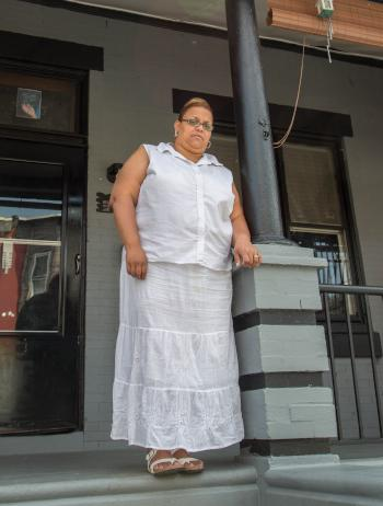 Norys Hernandez, pictured, nearly lost the rowhouse she and her sister owned after police arrested her nephew on drug dealing charges and seized the house. (Institute for Justice)