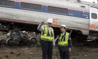 NTSB IIC Mike Flanigon briefs Vice Chairman Dinh-Zarr on the scene of the Amtrak Train #188 Derailment in Philadelphia, PA | NTSB, Creative Commons
