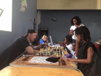 olunteers teach young kids to play chess at the After School Activities Fair at Francis Myers Reaction Center in Southwest Philly on September 21, 2018.