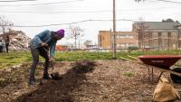 Tommy Joshua, one of the founders of the North Philly Peace Park, gets ready to plant vegetables. (Brad Larrison/for NewsWorks)