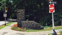 One of the remaining stone piers of the Stotesbury Gateway sustained considerable damage from a car crash months after the masonry was repointed. (Jana Shea/for Newsworks)