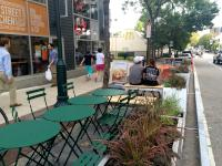 Parklet seating options include bistro tables and benches