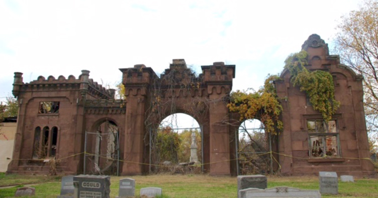 Parts of the brownstone gatehouse have been consumed by fire, and other sections have deteriorated and collapsed over the years. | Image courtesy of Friends of Mount Moriah Cemetery