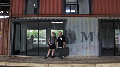 Photographer Jim Abbott and his daughter, filmmaker India Abbott, will share one of the studios made from glass-fronted shipping containers on the renovated Cherry Street Pier. | Emma Lee/WHYY News