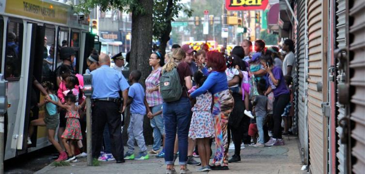 Police in North Philadelphia assist the reunification of kids and families after a lock down.
