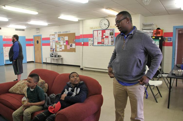 Quan King and a few of neighborhood kids enjoying Cobb Creek Rec Center's newly made lounge. (Emma Lee/WHYY)