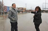 Rev. Clarence Hester and Tinamarie Russell point to North Station District development site. (Emma Lee/WHYY)