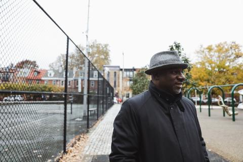 Rev. Mark Kelly Tyler at Weccacoe Playground standing at the site of the Bethel Burying Ground. (Neal Santos for PlanPhilly)