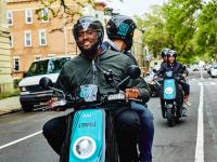Riders cruise through Brooklyn on Revel mopeds. (Revel)
