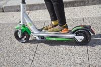 Riders were invited to test drive a new, brawnier Lime scooter at City Hall. (Kimberly Paynter/WHYY)