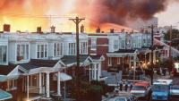 Rowhouses in Philadelphia burn after authorities dropped a bomb on the MOVE house in May 1985. (AP Photo, files)