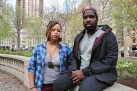 Shani Akilah and Abdul-Aliy Muhammad with the Black and Brown Workers Cooperative at Rittenhouse Square Park. (Emma Lee/WHYY)