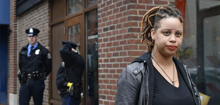Shani Akilah Robin was one of an estimated 50 people protesting the controversial arrest of two black Starbucks patrons at the chain's Rittenhouse location on April 16. (Bastiaan Slabbers/For WHYY)