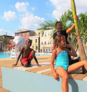 Siddiq Thurman, Ayeashi Daniels and Eleni Zorn (L to R) agree the improvements make their pool more fun.