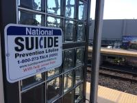 Sign for National Suicide Prevention Lifeline at Primos Station