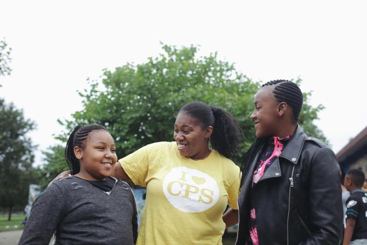 Sisters Kayla (left) and Kiarra Sils, seen here with their mom, say they're excited to visit the Discovery Center. | Neal Santos for PlanPhilly
