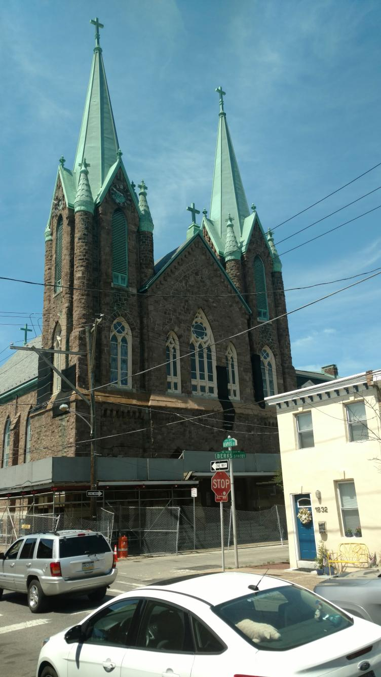 The former St. Laurentius church, surrounded last week by fencing. | Jake Blumgart/PlanPhilly