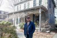 Temple Urban Education professor James Earl Davis outside of his home in East Germantown.