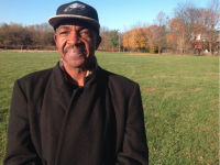 Terry Williams standing in one of Eastwick's polluted, urban renewal tracts.  (Credit:Troubled Waters project)