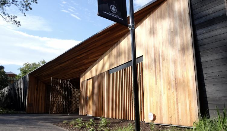 The Discovery Center's entrance is framed by smooth planes of cedar planks. | Ashley Hahn for PlanPhilly